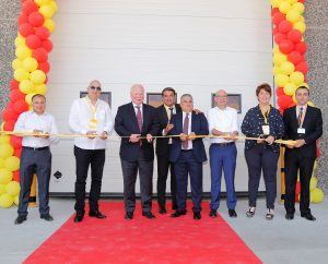 we Brinks, CEO DHL Freight (middle), cutting the ribbon together with DHL Freight employees at the Manisa warehouse opening ceremony. [Photo: DHL]